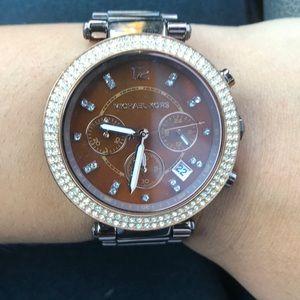 Used Michael Kors watch. Needs new battery